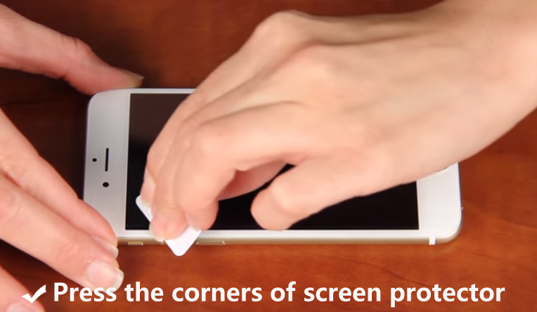 Press the corners of screen protector